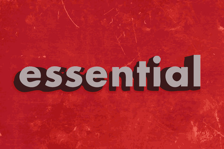essential: essential vector word on red concrete wall
