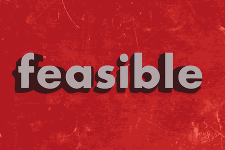 feasible: feasible vector word on red concrete wall
