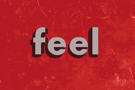 by feel: feel vector word on red concrete wall