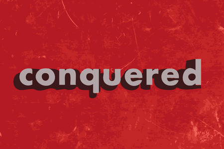 conquered: conquered vector word on red concrete wall