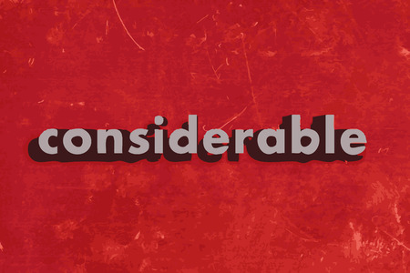 considerable: considerable vector word on red concrete wall