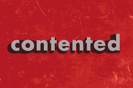 contented: contented vector word on red concrete wall
