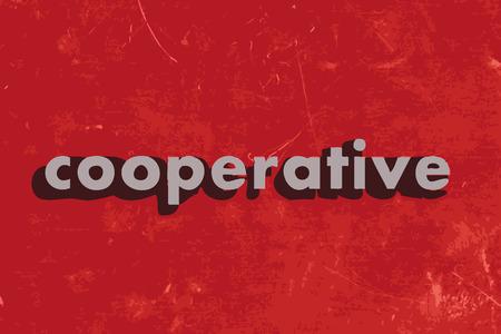 cooperativismo: palabra vector cooperativa en rojo muro de hormig�n Vectores