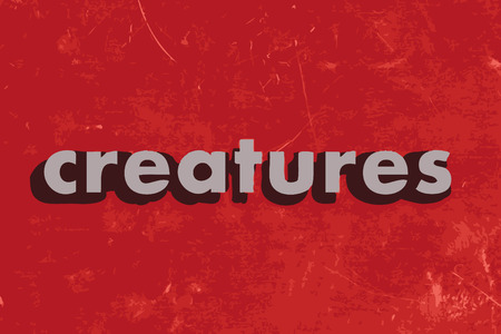 creatures: creatures vector word on red concrete wall