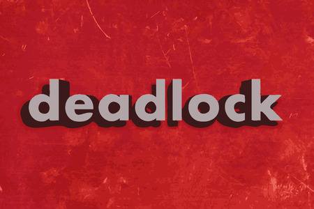 deadlock: deadlock vector word on red concrete wall