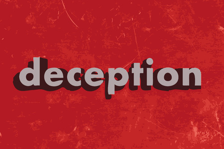 deception vector word on red concrete wall