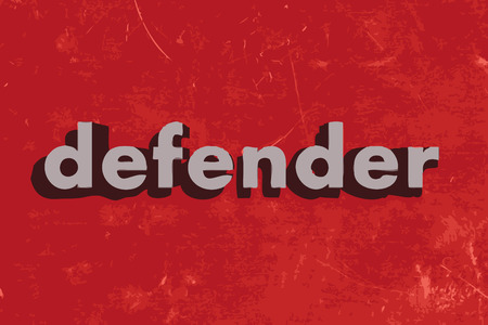 defenders: defender vector word on red concrete wall