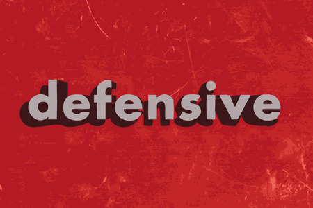 defensive: defensive vector word on red concrete wall
