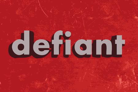defiant: defiant vector word on red concrete wall