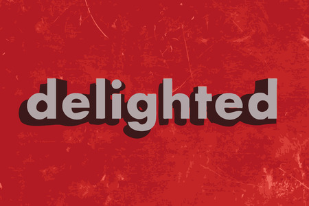 delighted: delighted vector word on red concrete wall