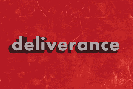 d�livrance: mot de vecteur de d�livrance sur le mur de b�ton rouge