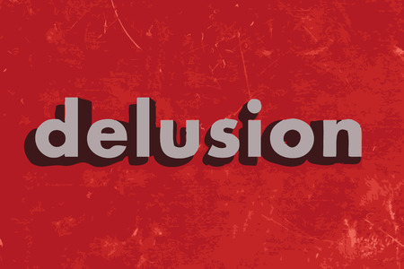delusion: delusion vector word on red concrete wall