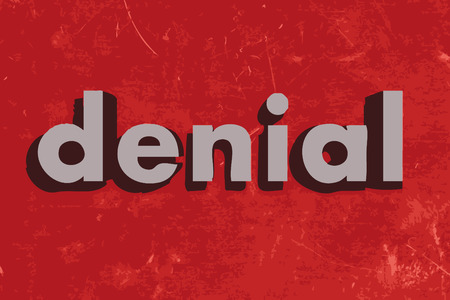 denial: denial vector word on red concrete wall