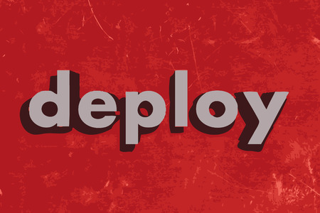 deploy: deploy vector word on red concrete wall
