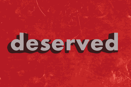 deserved: deserved vector word on red concrete wall