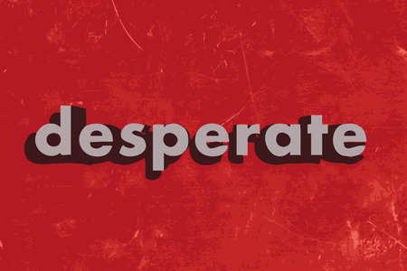desperate: desperate vector word on red concrete wall