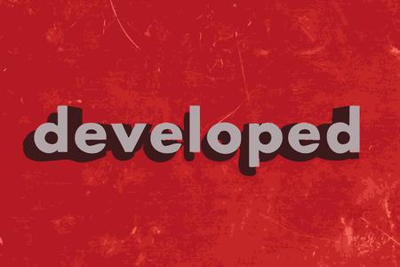 developed: palabra vector desarrollada en rojo muro de hormig�n