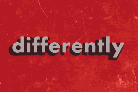 differently: differently vector word on red concrete wall