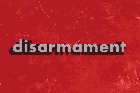 disarmament: disarmament vector word on red concrete wall