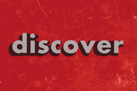 discover: discover vector word on red concrete wall