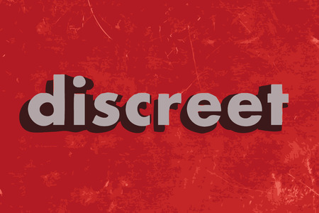 discreet: discreet vector word on red concrete wall