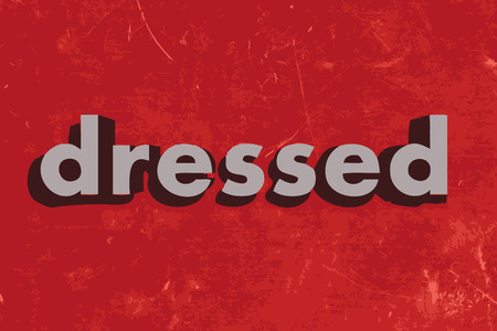 dressed: dressed vector word on red concrete wall