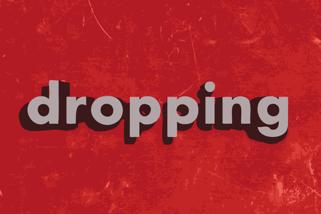 dropping: dropping vector word on red concrete wall