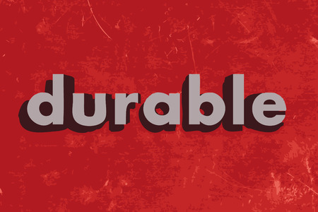 durable: durable vector word on red concrete wall