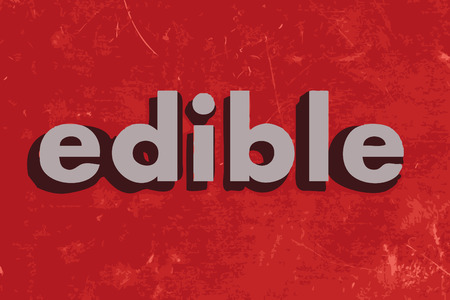 edible: edible vector word on red concrete wall