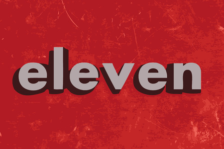 eleven: eleven vector word on red concrete wall