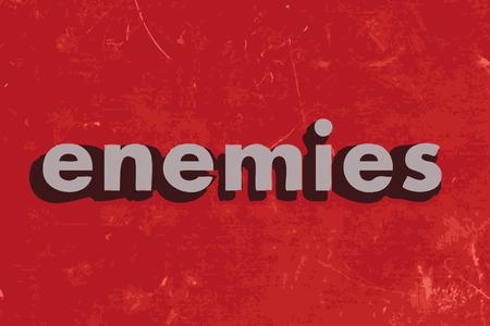 nemici: nemici vettore parola sul muro di cemento rosso