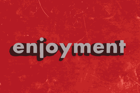 enjoyment: enjoyment vector word on red concrete wall