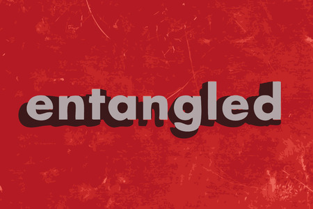 entangled: entangled vector word on red concrete wall