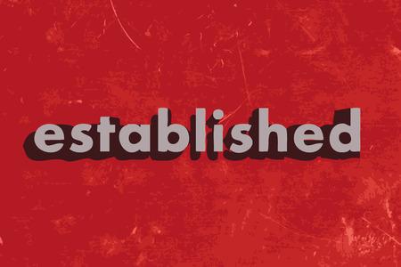 established: established vector word on red concrete wall