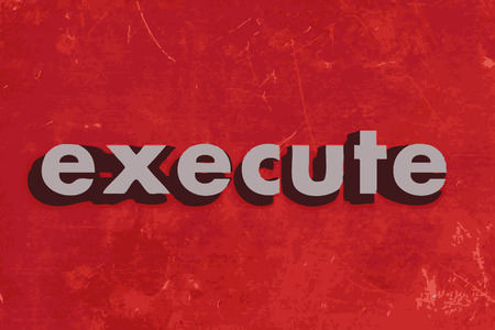 execute: execute vector word on red concrete wall