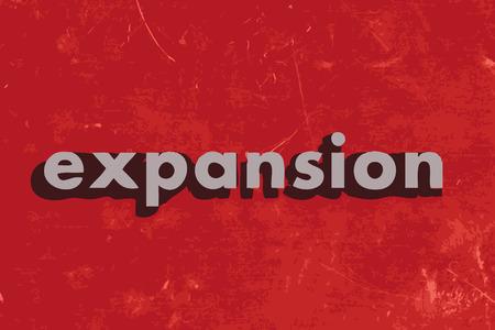 expanding: palabra de expansi�n del vector en rojo muro de hormig�n Vectores