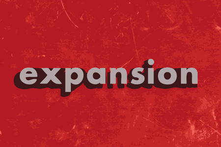 expansion vector word on red concrete wall