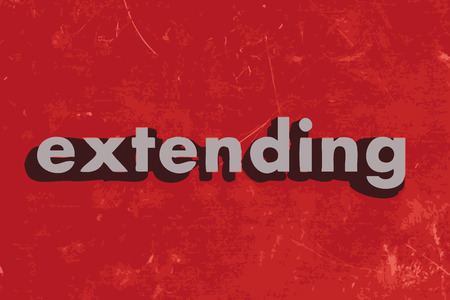 extending: extending vector word on red concrete wall