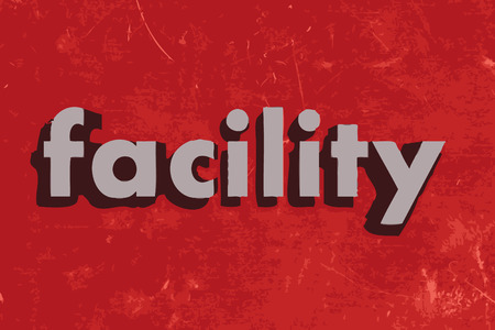 facility: facility vector word on red concrete wall