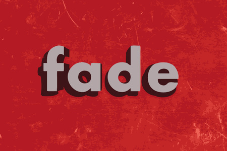 페이드: fade vector word on red concrete wall