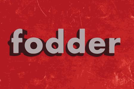 fodder: fodder word on red concrete wall