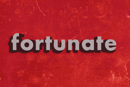 fortunate: fortunate word on red concrete wall