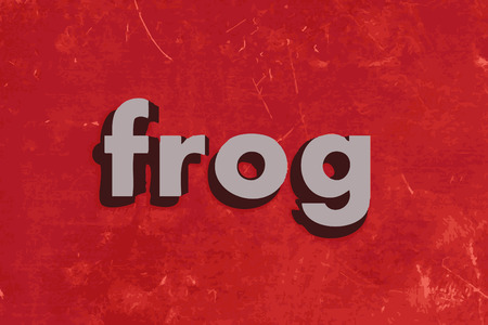 red frog: frog word on red concrete wall