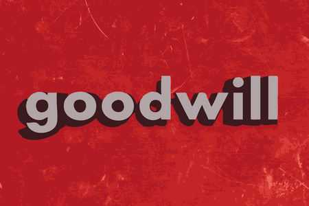 goodwill: goodwill word on red concrete wall
