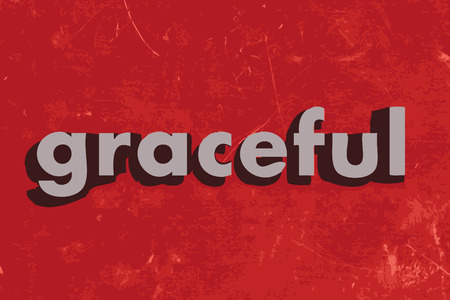 graceful: graceful word on red concrete wall