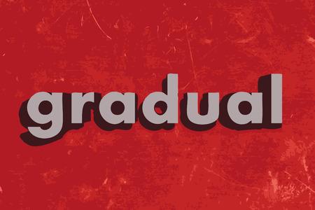 gradual: palabra gradual en rojo muro de hormig�n