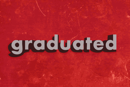 graduated: graduated word on red concrete wall