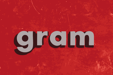 gram: gram word on red concrete wall