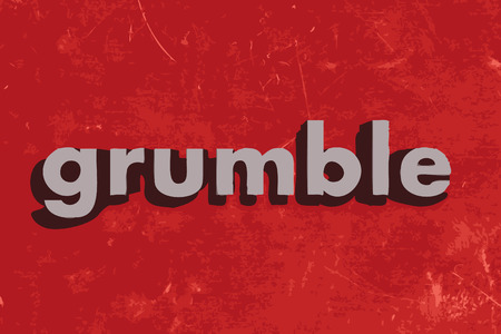 grumble: grumble word on red concrete wall