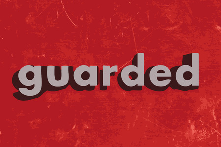 guarded: guarded word on red concrete wall